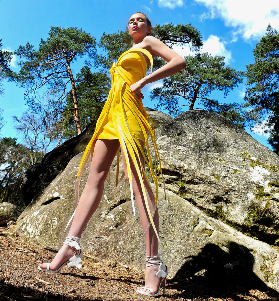 Galatea wearing the yellow dress from the 2021 Summer collection