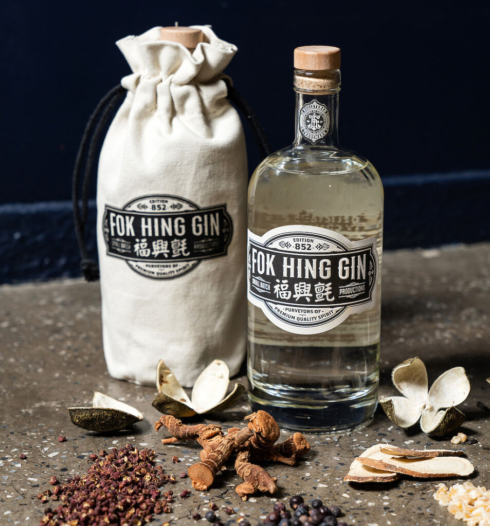 A bottle of the gin with its holding bag and botanicals