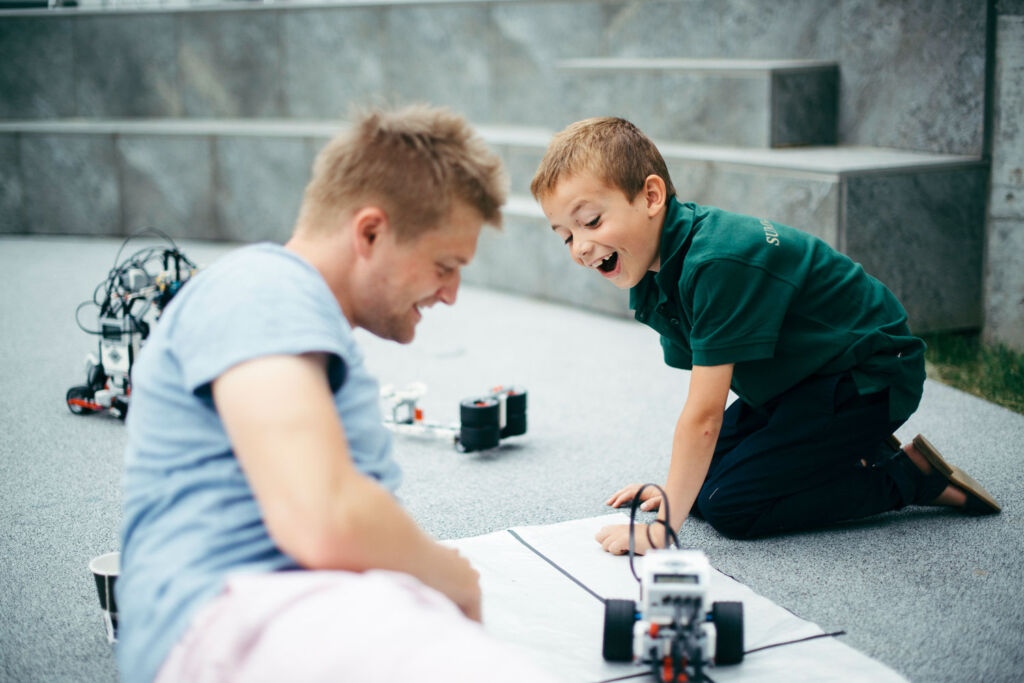 A young student learning about robotics at the Institut auf Dem Rosenberg