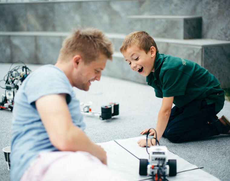 A young student learning about robotics