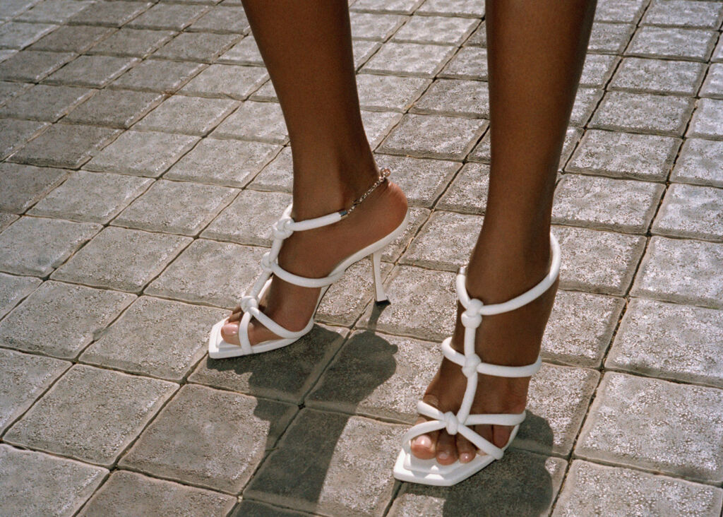 A pair of Bay Strappy Sandals in white