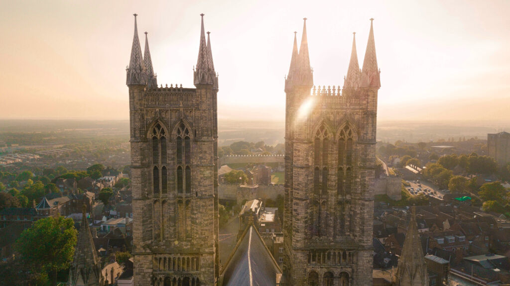 The twin spires of Lincoln Cathedral at sunset