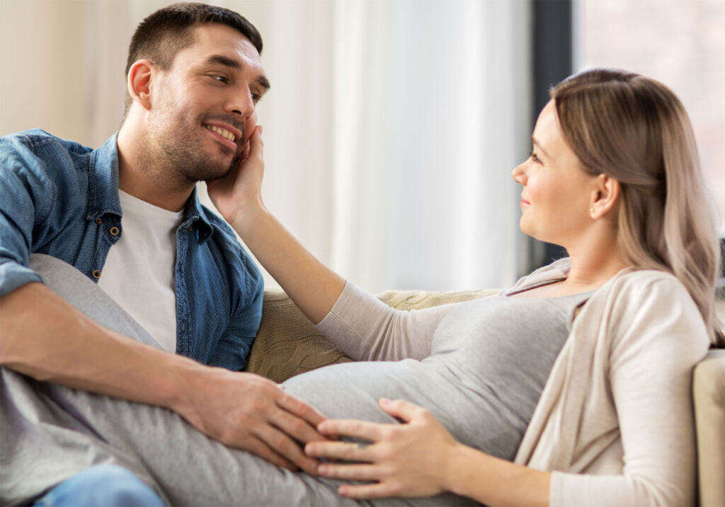 Man touching his pregnant partners stomach