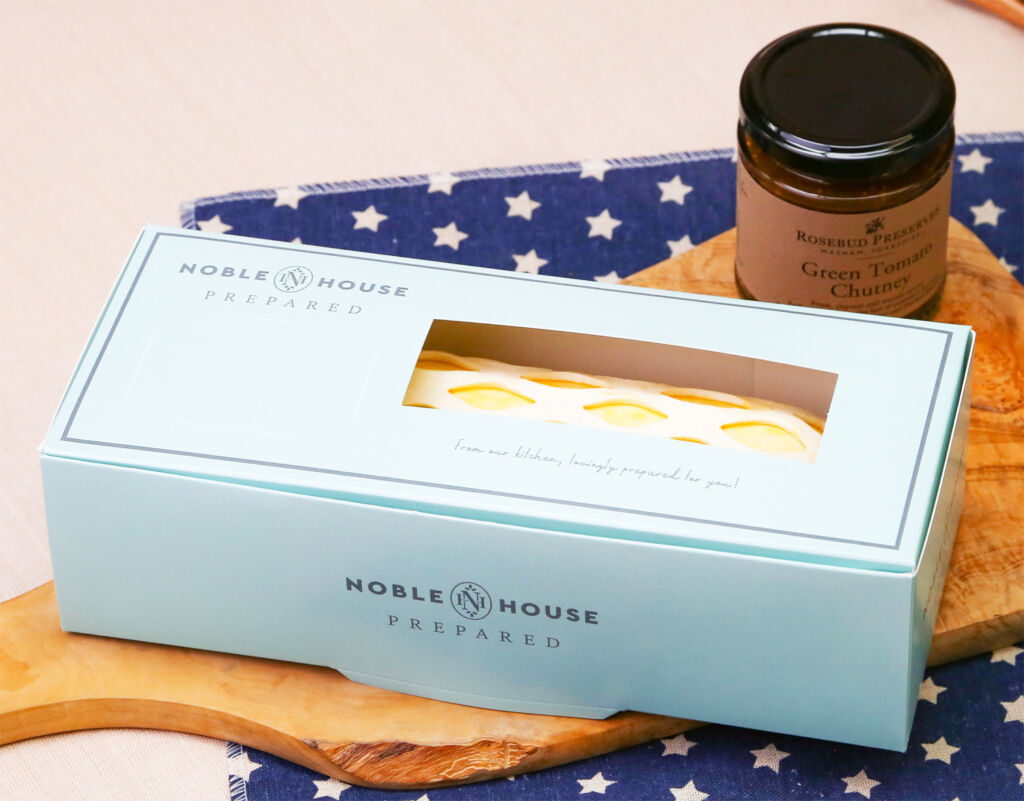 The sausage roll in it's Noble House branded box