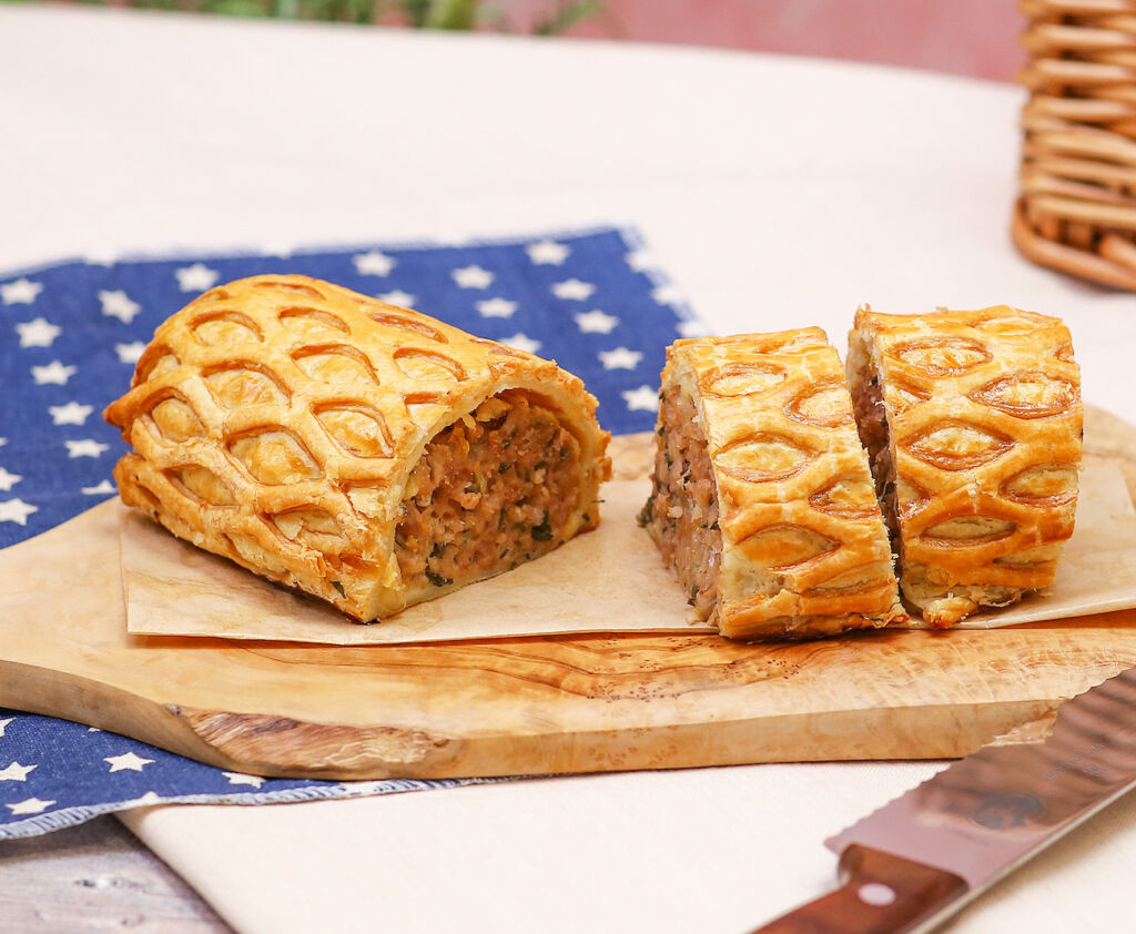 The huge sausage roll sliced into more manageable pieces