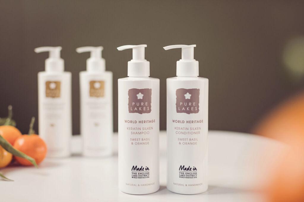 Bottles of the brand's Sweet Orange and Basil Keratin Silken Shampoo