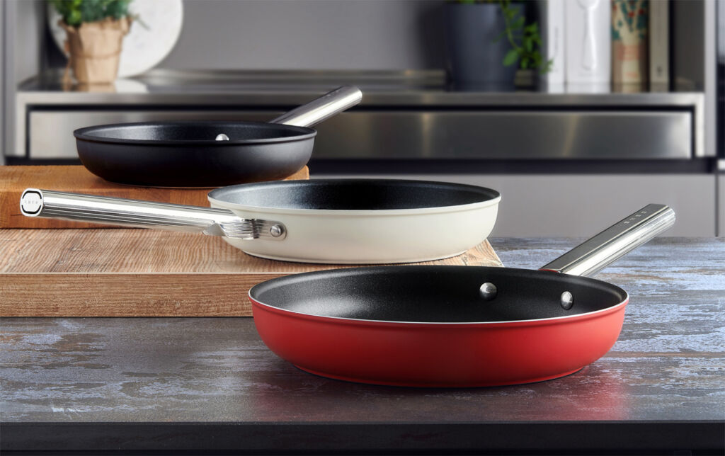 SMEG frying pans in red cream and black