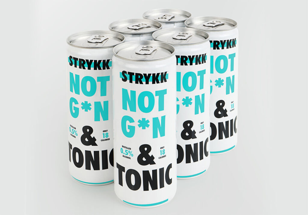 Six STRYKK NOT GIN and Tonic cans on a table