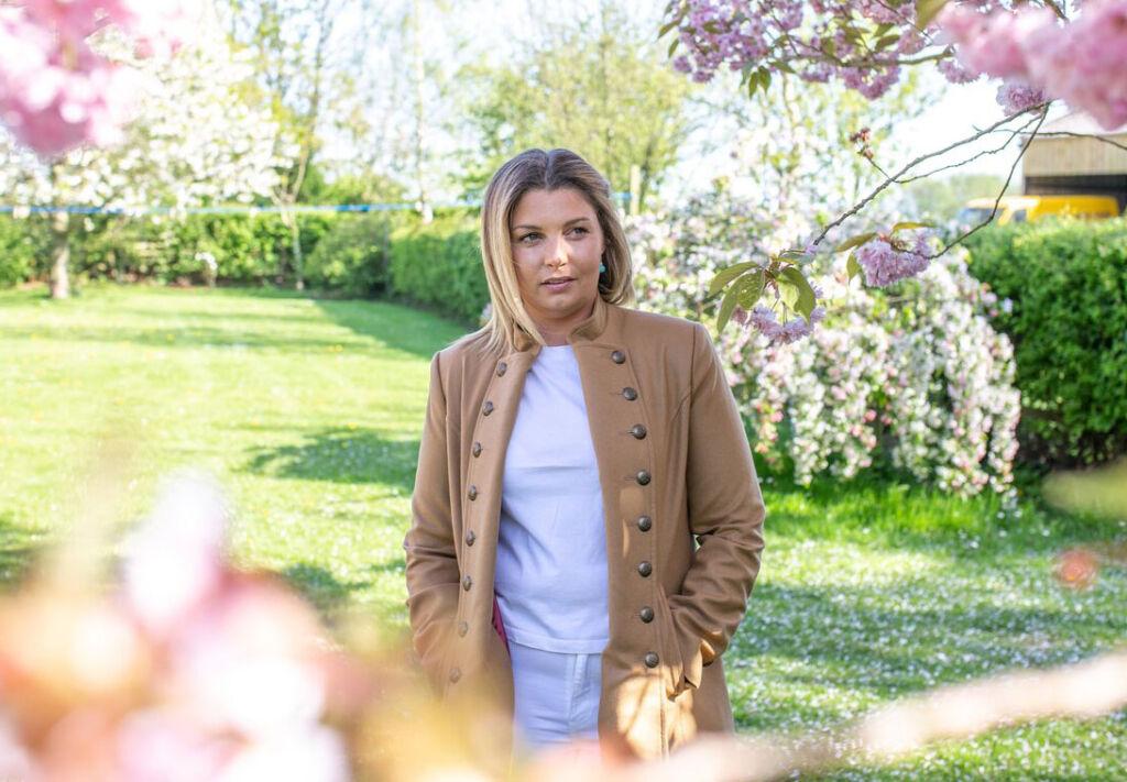 Sophie Osborne standing in a garden