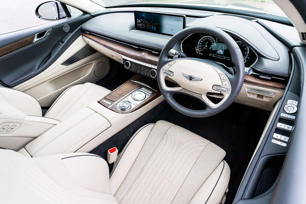 A luxurious cream leather interior inside the G80