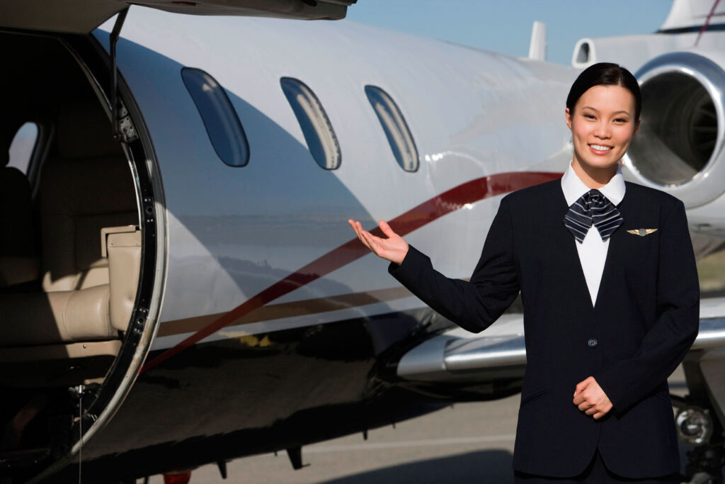 Woman welcoming guests onto a private jet