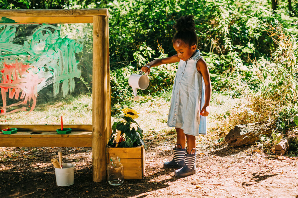 Young girl learning to paint with Plum Play