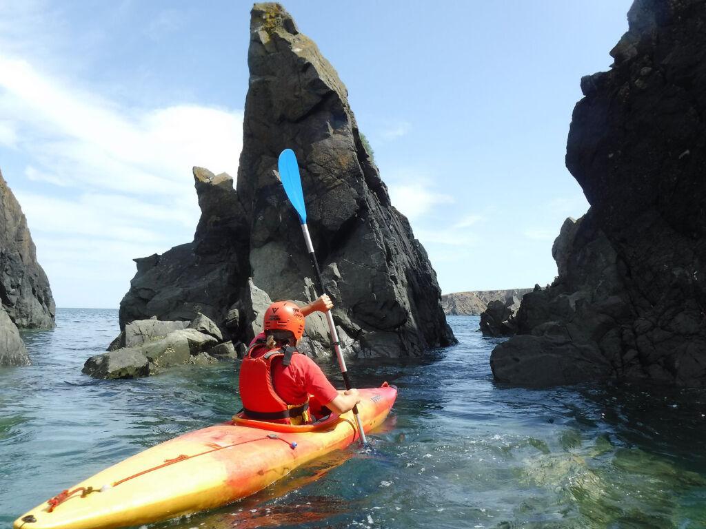 A woman sea kayaking with Preseli Venture