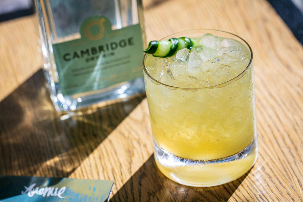 The Gin Emporium is a collaboration with Cambridge Distillery, this images shows one of their bottles with a glass of gin