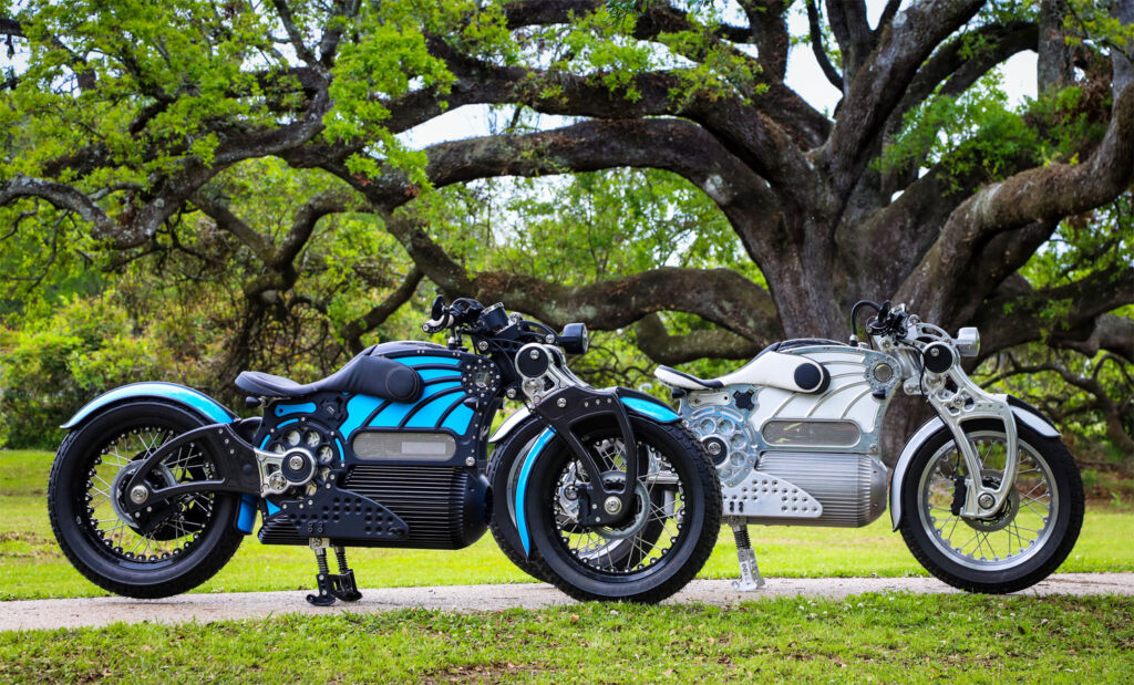 Blue and white versions of Curtiss Motorcycles The One parked side by side