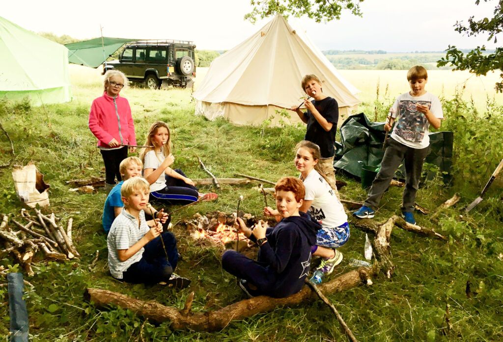 Children toasting marshmallows over a fire at Home Farm