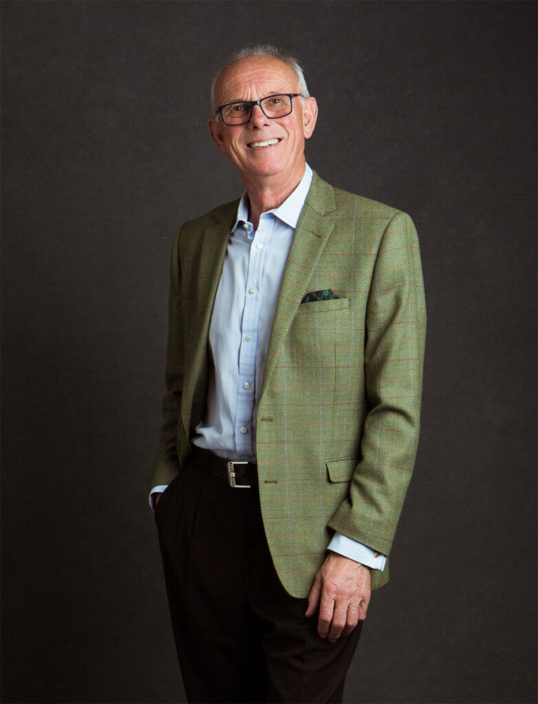 Photo of Colin Scott dressed in a shirt with a green tweed jacket