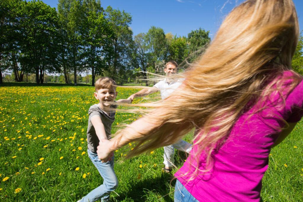 A family enjoying some vigorous exercise outdoors