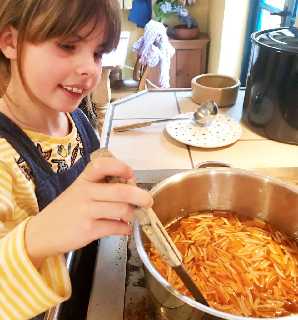 Flora Rider making marmalade