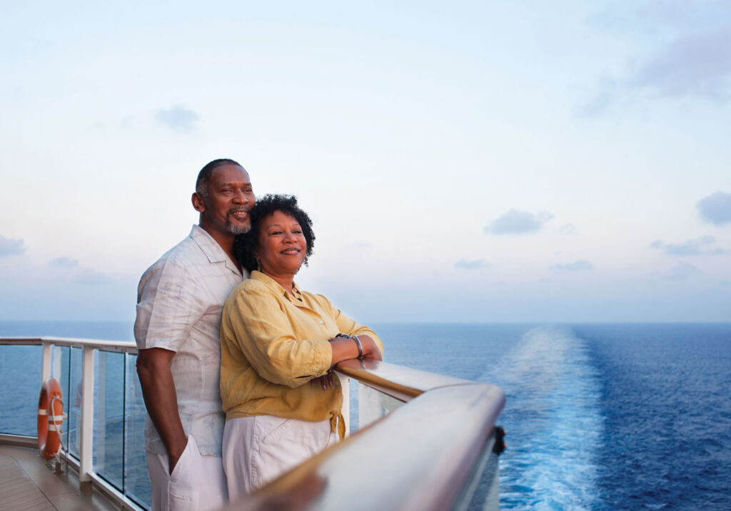A couple enjoying the views from the ships deck