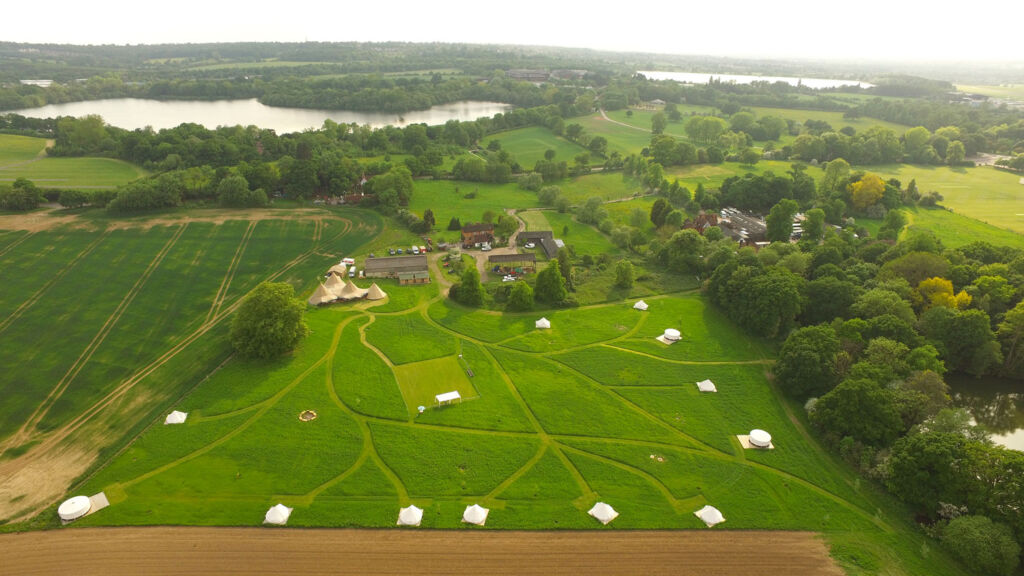 An aerial view of the glamping site
