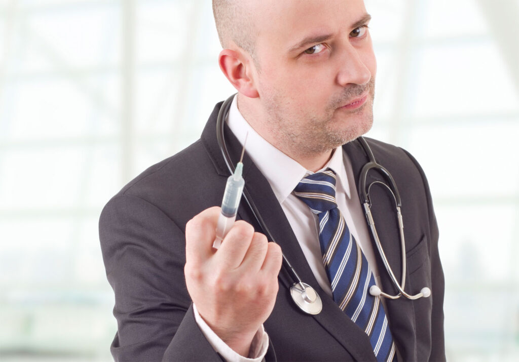 A doctor ready to administer a vaccine