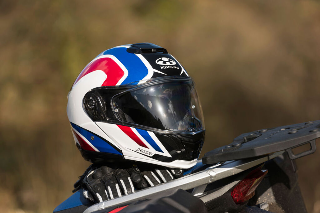 Kabuto helmet on a bike tank in red white and blue