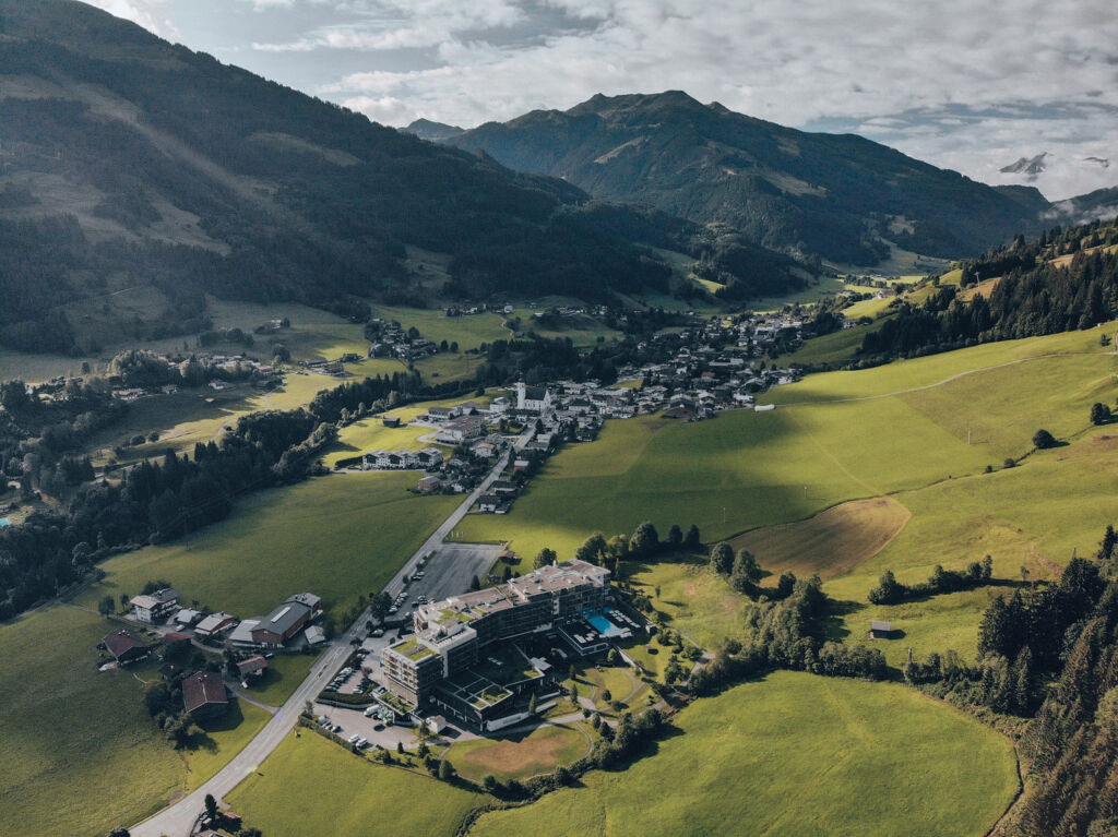 An aerial view of the hotel complex surrounded by mountains and beautiful countryside