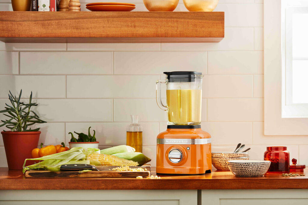 The blender in a honey colour sat on the kitchen counter