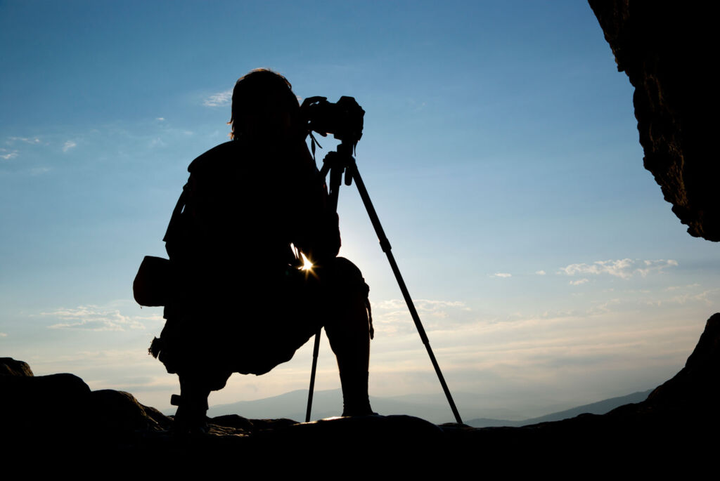 A person on top of a hill, shooting video in low light