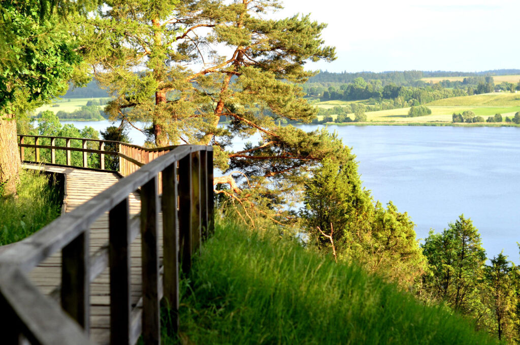 A wooden path by a lake devoid of people