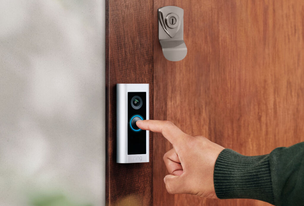 A person pressing the Ring Doorbell Pro 2