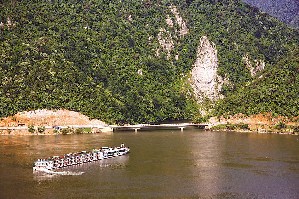 Cruising down the river passing the Iron Gate monument in Serbia