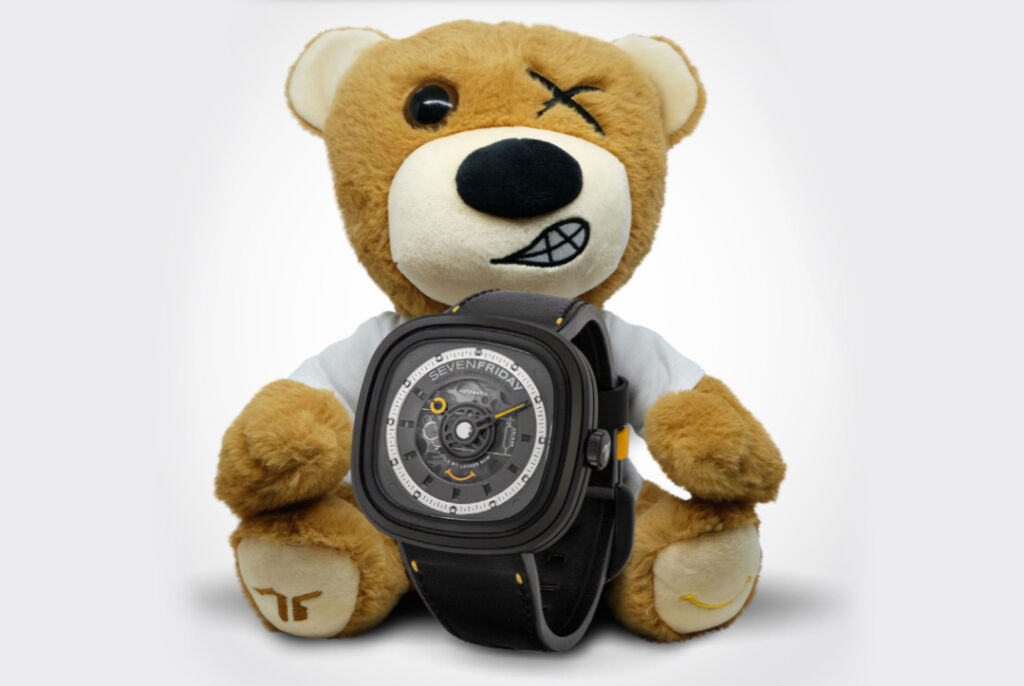 Sevenfriday's Riley Bear holding the new T1/02 Micah's Voice timepiece