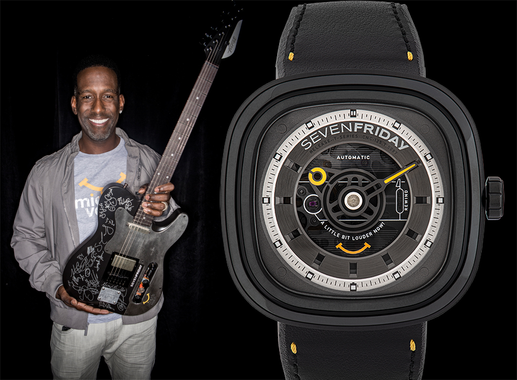 Shawn Stockman holding the guitar which was auction for charity