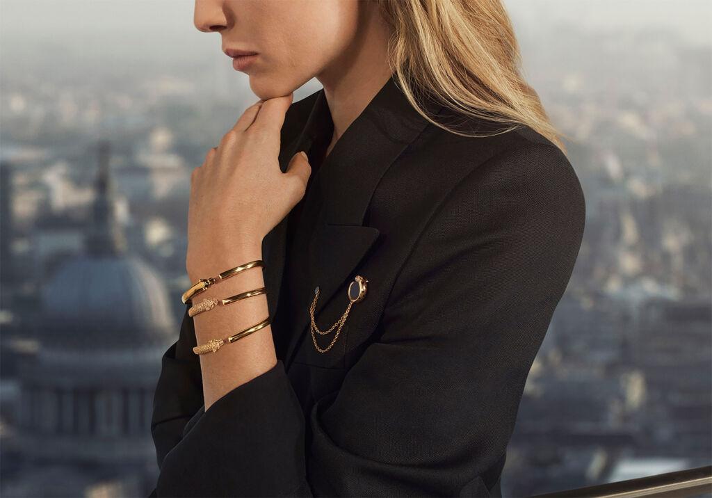 Model wearing three versions of the bracelet