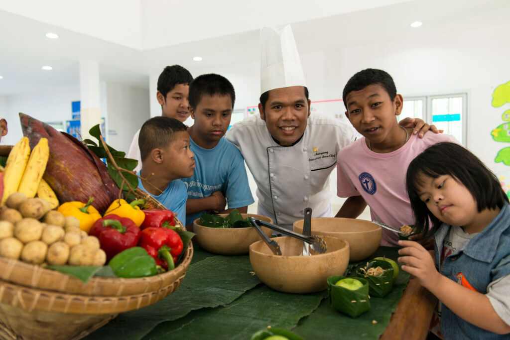 Some of the children cooking with Executive Chef Gogh