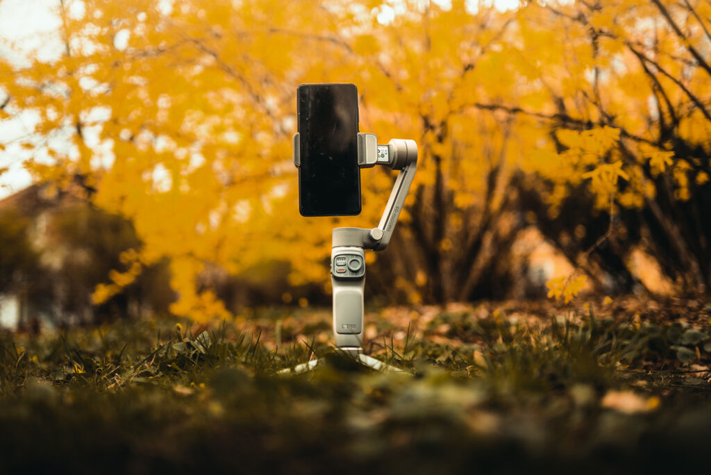 The gimbal on its tripod outdoors in the Autumn