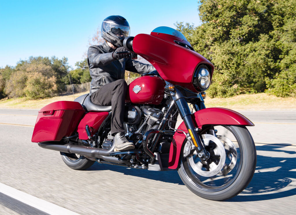 The motorcyle being ridden showing the well positioned seat which makes it extremely comfortable for the rider