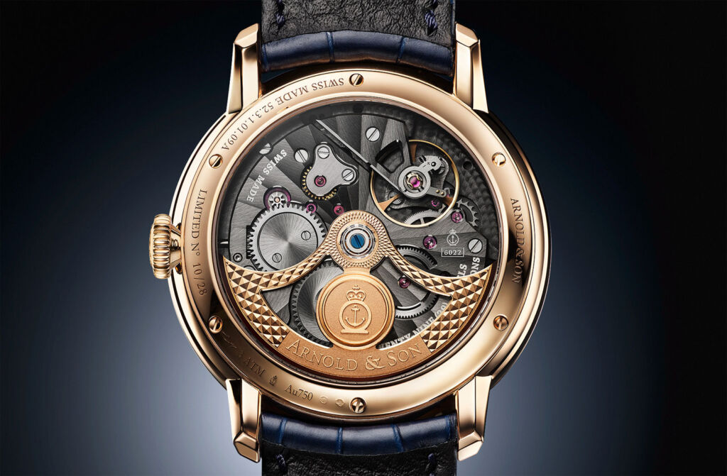 A closeup view of the rear of the watch showing the gold movement