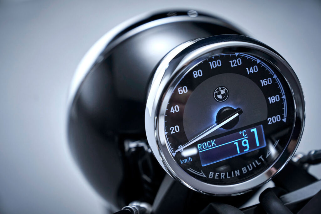 A close up view of the bikes speedometer housed in a circular case which combines heritage with modern day technology
