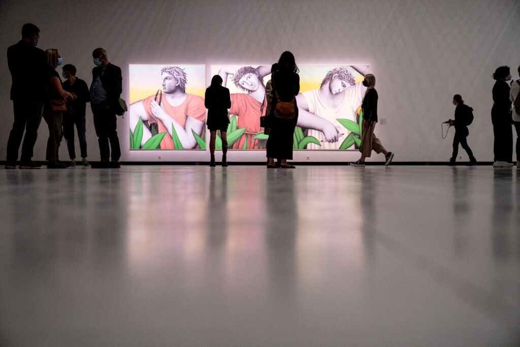 Visitors viewing the art projected on the walls at Baltic Triennial 14