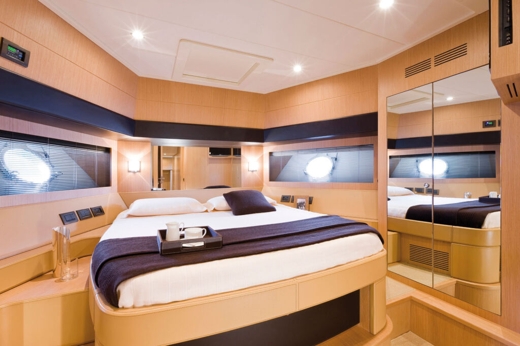 Inside one of the cabins on a Riva boat which shows the liberal use of woods used in its construction