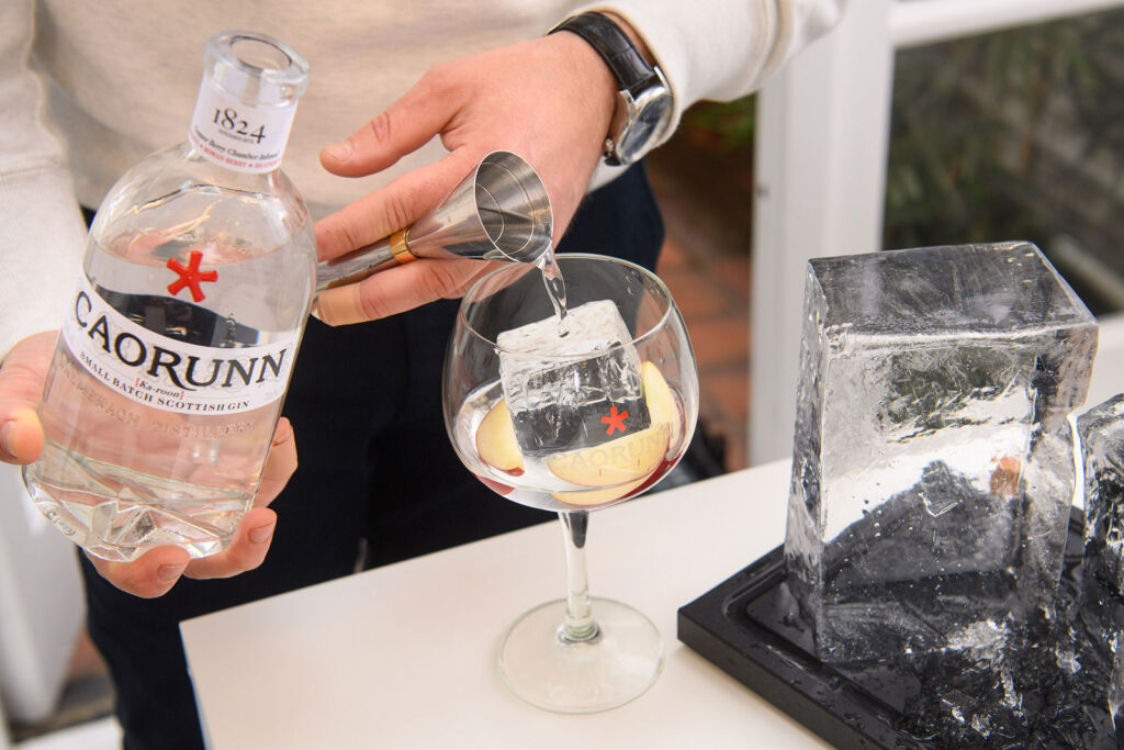 Caorunn Gin being poured into an ice filled glass