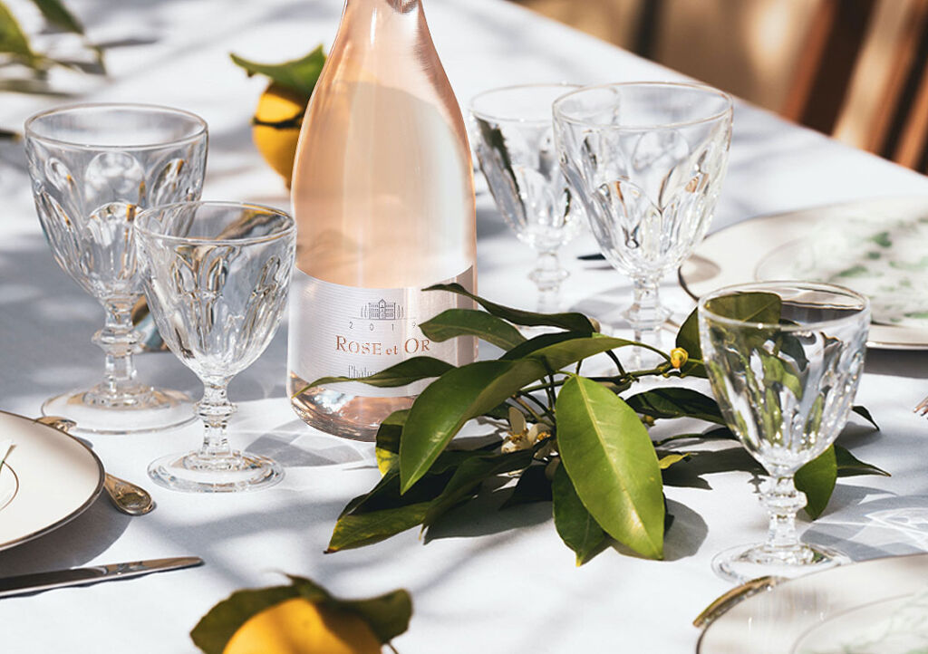 A bottle of Château Minuty Rose et Or on a beautifully decorated dining table