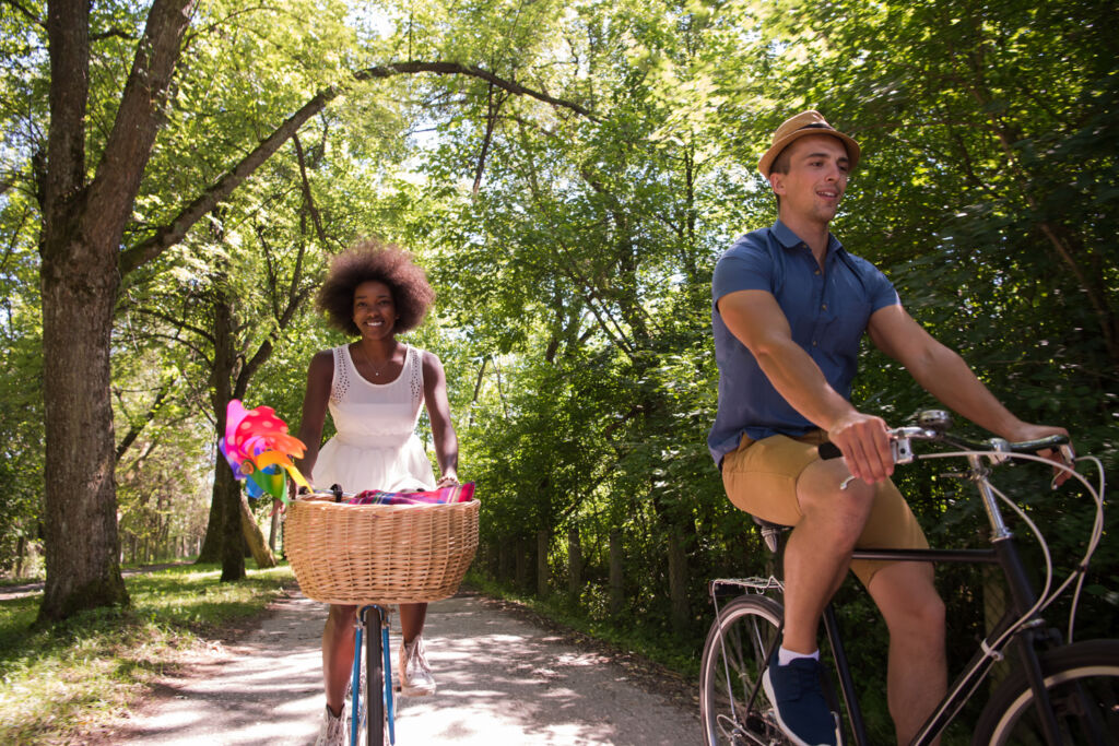 A young couple on a leisurely bike ride in the countryside