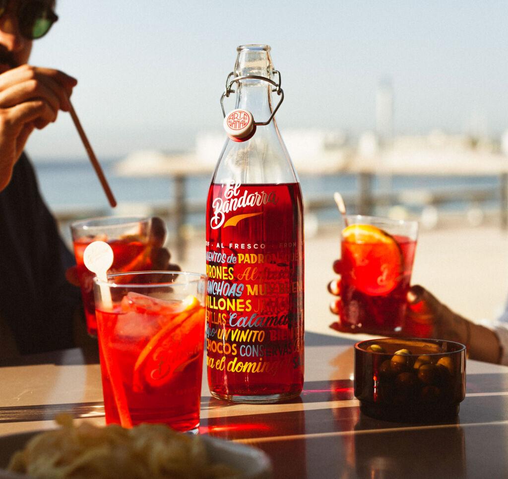 A bottle of El Bandarra being enjoyed on the beach