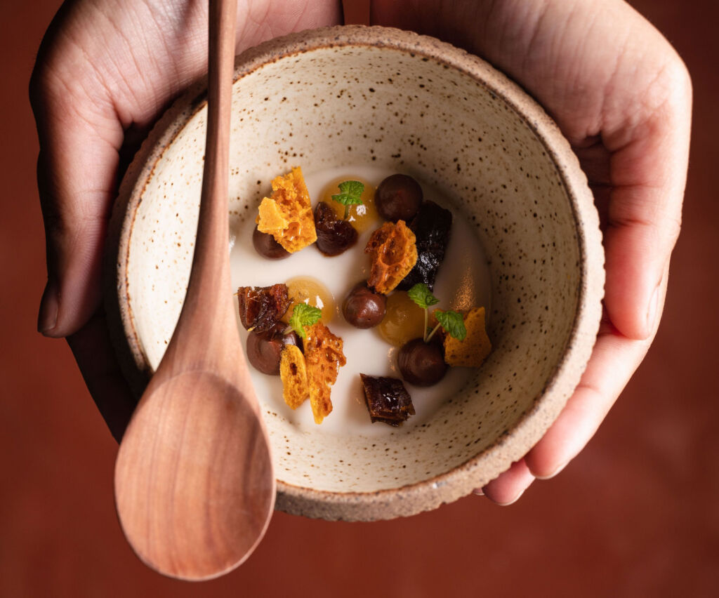 Tiger nut panna cotta with smoked chocolate ganache, honeycomb, dates cooked in rum, dark chocolate and caramel brittle.