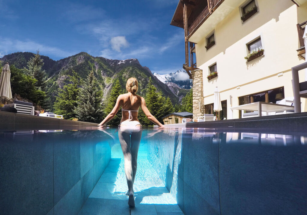A young woman walking through an outdoor spa pool