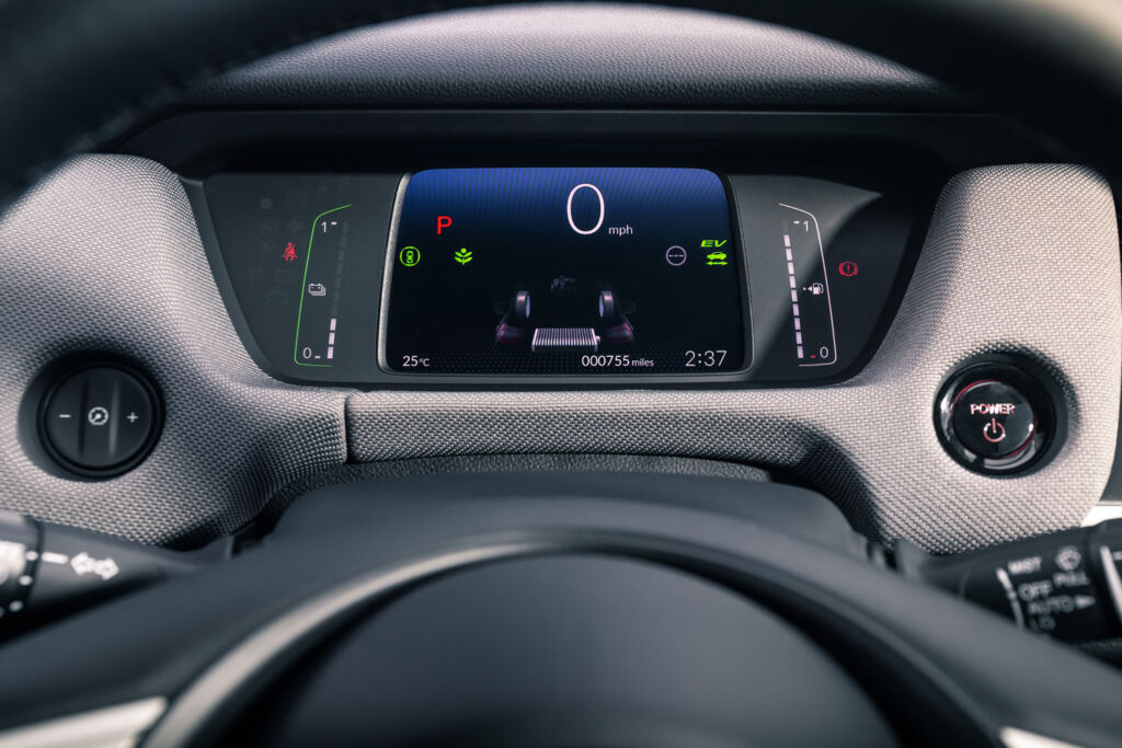 The drivers screen behind the steering wheel which feeds information such as remaining power etc.
